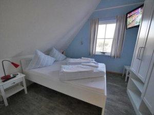 Ferienhaus Rügen mit Meerblick in Ummanz für 8 Personen - Schlafzimmer